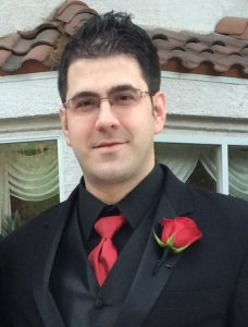 Ron Spinabella dressed in a tuxedo as a groomsmen at his cousins wedding